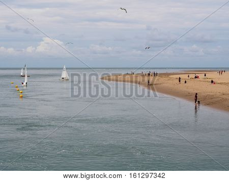 View of sailing boats and the beach at Aberdovey Gwynedd Wales. Aberdovey is a beautiful little village on the sea at the southern tip of the Snowdonia National Park. Despite its history as a shipping village in the 19th century the Aberdovey of today is