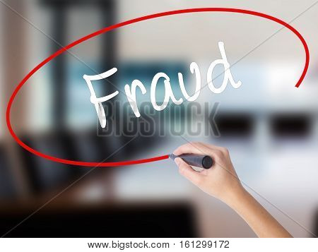 Woman Hand Writing Fraud With A Marker Over Transparent Board