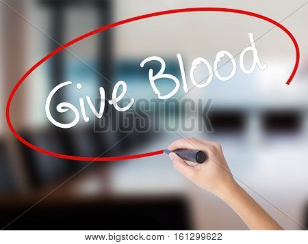 Woman Hand Writing Give Blood  With A Marker Over Transparent Board