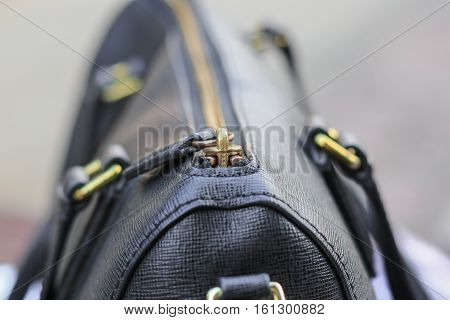 Close up zipper of black leather bag