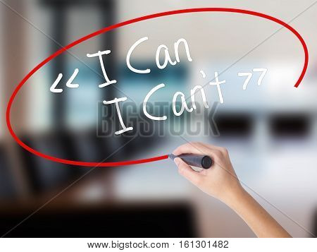 Woman Hand Writing I Can - I Can't With A Marker Over Transparent Board