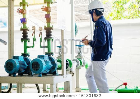 Technician servicing an water Motor Cooling Tower in factory