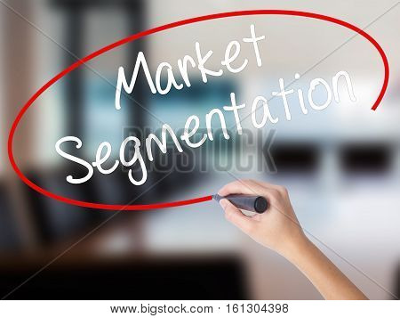 Woman Hand Writing Market Segmentation With A Marker Over Transparent Board.