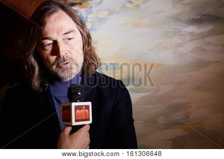 MOSCOW, RUSSIA - JUN 06, 2016: Artist Nikas Safronov gives interview at the ceremony of awarding Fashion People Awards in hotel DoubleTree by Hilton Moscow - Marina.