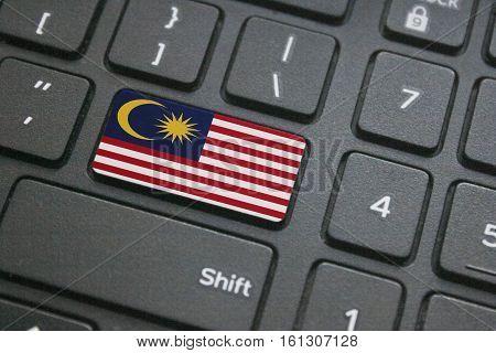 Close up of Malaysian flag on computer keyboard
