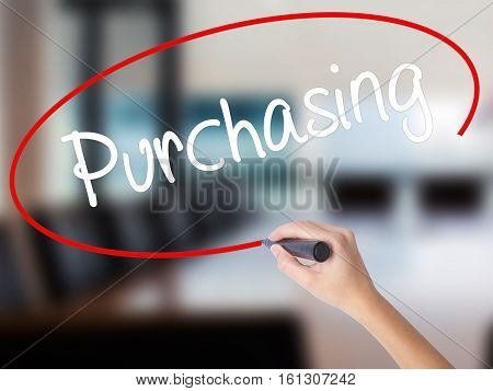 Woman Hand Writing Purchasing With A Marker Over Transparent Board.