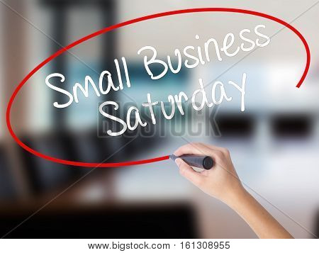 Woman Hand Writing Small Business Saturday With A Marker Over Transparent Board