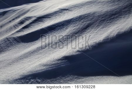 background of winter snow like barchan, shiny snowflake