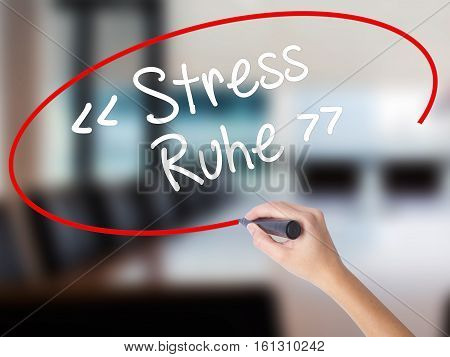 Woman Hand Writing Stress Ruhe  (stress - Peacein German) With A Marker Over Transparent Board.