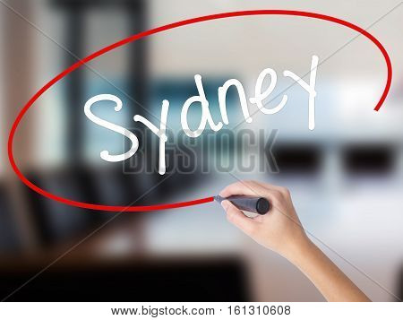 Woman Hand Writing Sydney  With A Marker Over Transparent Board