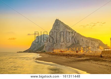 View on Gibraltar rock at sunset from beach in La Linea de la Concepcion Andalusia Spain