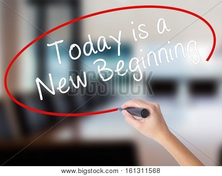 Woman Hand Writing Today Is A New Beginning With A Marker Over Transparent Board