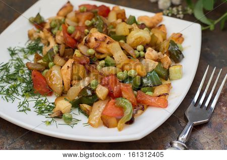 Vegetable Saute and roasted chicken. Rural background.