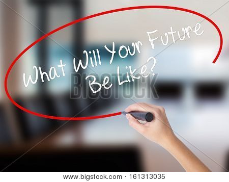 Woman Hand Writing What Will Your Future Be Like? With A Marker Over Transparent Board