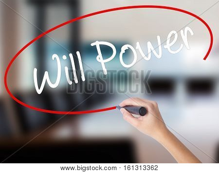 Woman Hand Writing Will Power With A Marker Over Transparent Board