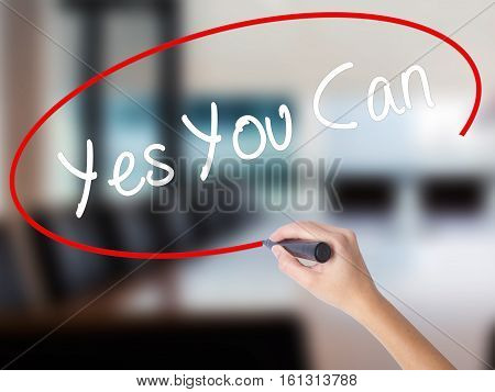 Woman Hand Writing Yes You Can With A Marker Over Transparent Board.