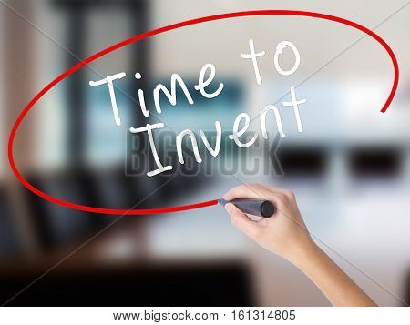 Woman Hand Writing Time To Invent With A Marker Over Transparent Board