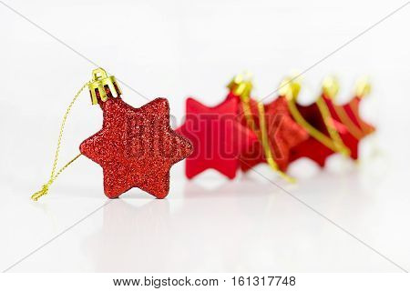 Closeup image of a christmas red star decoration, over a white background.