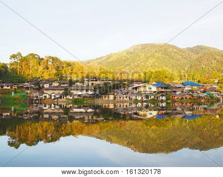 Village and lake landscape view in the evening at Rak Thai Village Mae Hong Son Province Thailand
