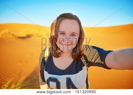 Happy Smiling Tourist Taking Selfie In Sahara Desert