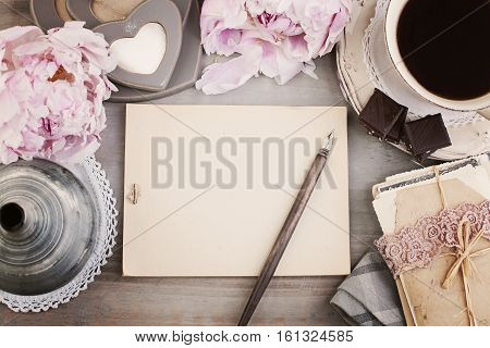 Vintage Frame with Black Coffee Flower Pen and Old Paper Background