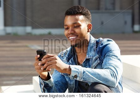 Smiling African American Man Holding Smart Phone