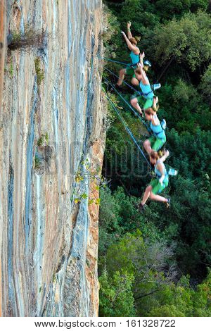 Female Climber falling down off high vertical rocky Wall combined from multiple high speed shoot
