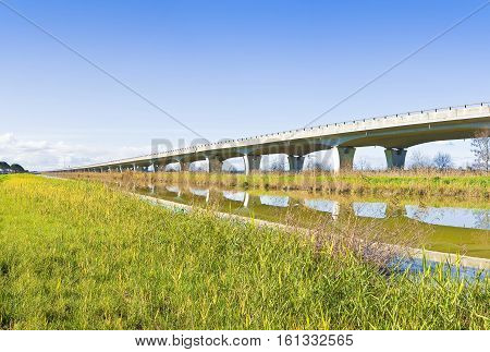 Elevated highway built built along a river with reinforced prefabricated concrete structure (Italy) -panoramic view