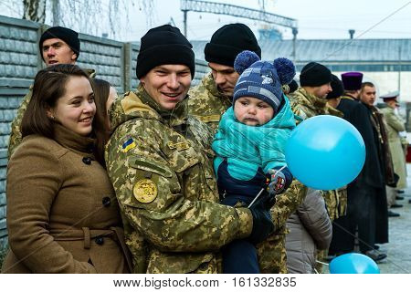 Chop Ukraine - December 6 2016: A soldier and his family rejoice received a new apartment during the presentation ceremony of the keys. On this day in Chop 23rd soldiers who served in the ATO it was handed the keys to new apartments.