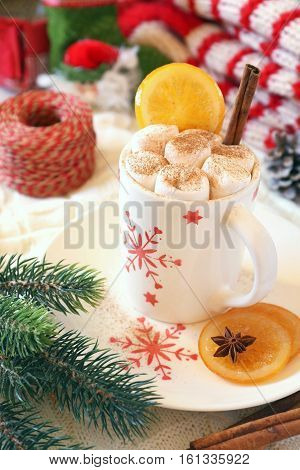 Winter drink: cup of hot chocolate with marshmallow and New Year decoration. Toned image