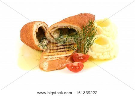 chicken and chicken Kiev with mashed potatoes. Chop chicken fillet stuffed with juicy butter, cheese and greens on white background.