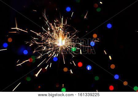 Sparkler on bokeh background. Christmas sparkler.Christmas background.