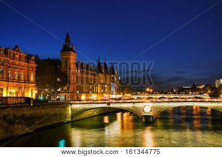 The Conciergerie building in Paris France in the night