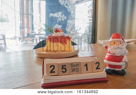 Christmas day and new year Santa Claus strawberry cheese cake on wooden table day time / Christmas cake