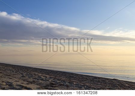 Beautiful Clear Sky And Water Of Ocean, Mountain In Horizon.