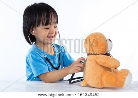 Happy Asian Chinese Little Doctor Girl Examine Teddy Bear