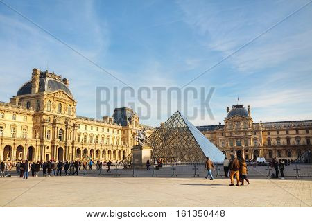 PARIS - NOVEMBER 1: The Louvre Pyramid on November 1 2014 in Paris France. It serves as the main entrance to the Louvre Museum. Completed in 1989 it has become a landmark of Paris.