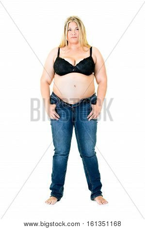 Overweight Woman In A Bra And Unzipped Jeans