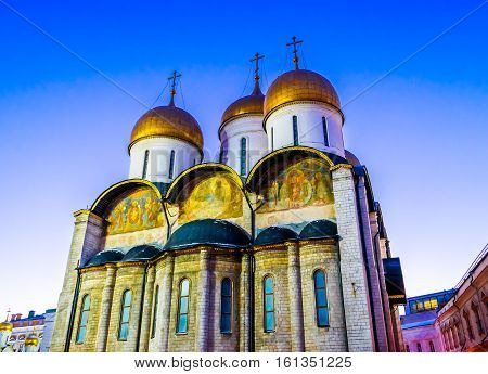 Facade of the Assumption Cathedral (Cathedral of the Dormition Uspensky sobor) of the Moscow Kremlin at sunset