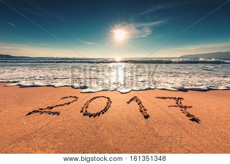 Happy New Year 2017 Concept On The Sea Beach; Sunrsie Shot