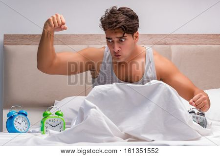 Man having trouble waking up in the morning