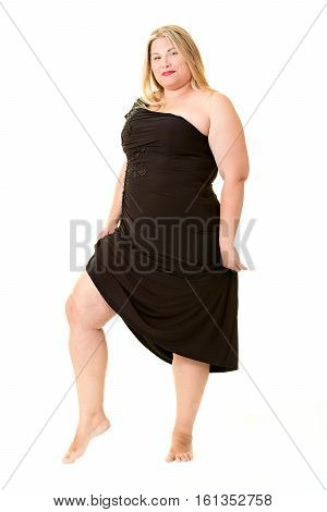 Attractive overweight woman in black evening dress full length on white