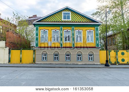 Old wooden brightly painted house in Old Tatar Sloboda in Kazan