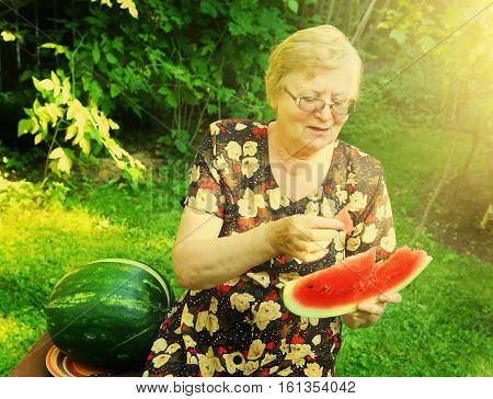 pensioner old woman with water melon slice