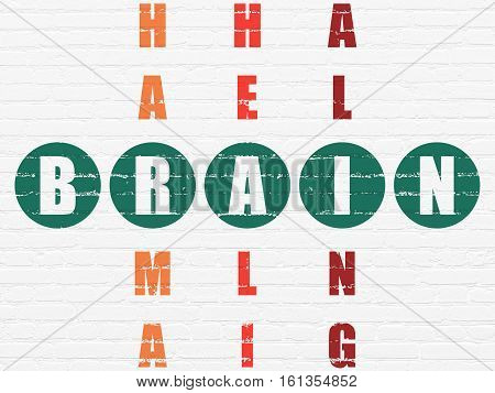 Health concept: Painted green word Brain in solving Crossword Puzzle