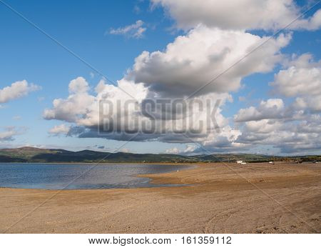Clouds and estuary at Ynyslas at the head of the Dyfi (Dovey) estuary just north of Borth Ceredigion Wales.