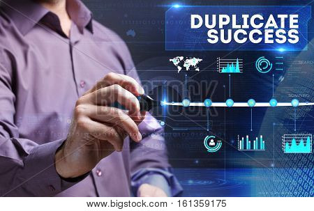 Technology, Internet, Business And Marketing. Young Business Person Sees The Word: Duplicate Success