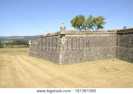 VALENCA, PORTUGAL - AUGUST 7, 2016: Defensive walls of the fortress in the village of Valenca a town located in the frontier with Spain in Portugal.