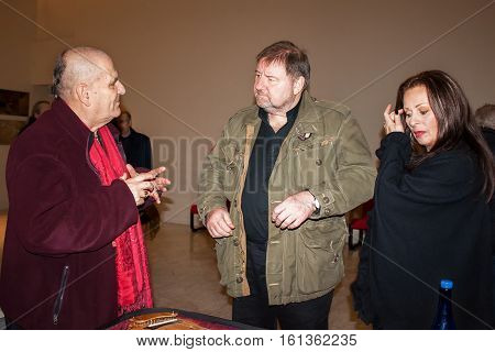 PIACENZA ITALY - DECEMBER 28 2012: Meeting of famous English singer musician songwriter member of progressive rock bands King Crimson and Emerson Lake&Palmer Greg Lake with Paolo Tofani