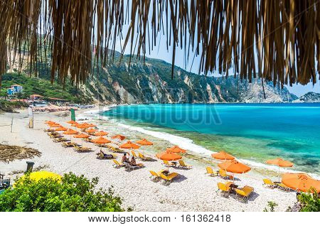 KEFALONIA ISLAND, GREECE - August 8, 2015: People relaxing at the beach of Petani, Kefalonia island, Greece.